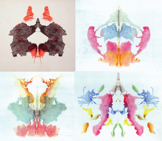 These pictures show four examples of Rorschach inkblot tests.