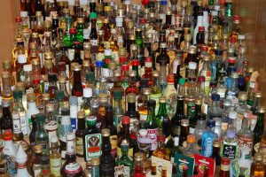 This picture shows a large variety of bottles of alcohol.