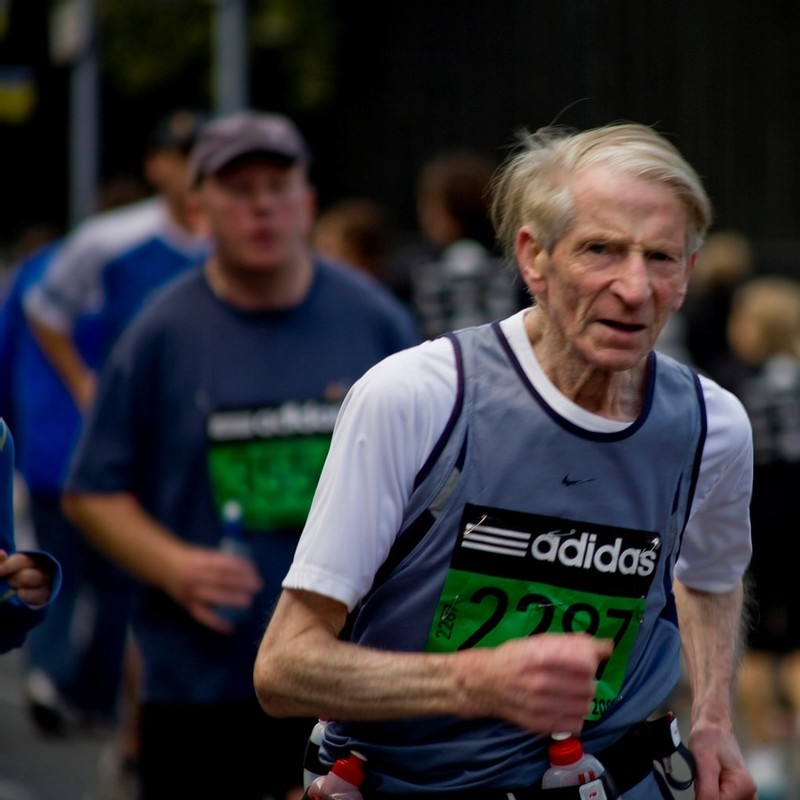 This picture shows a senior citizen running in the Dublin City Marathon.