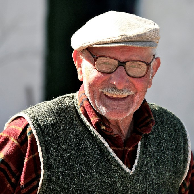 This picture shows a fit looking older gentleman smiling in the sunshine.