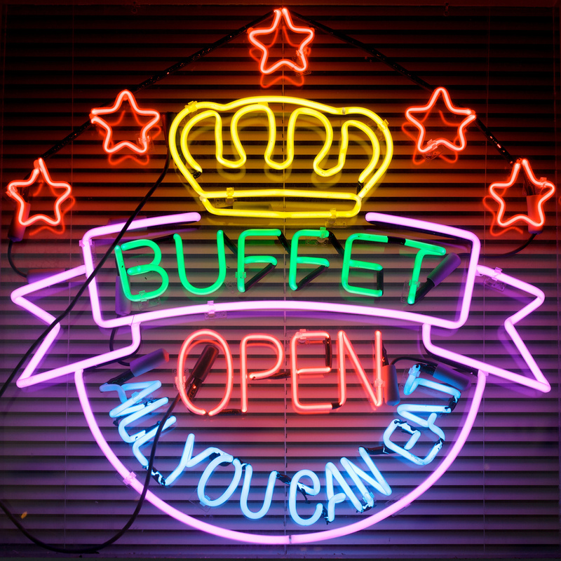 This picture shows a neon sign advertising an all-you-can-eat buffet.